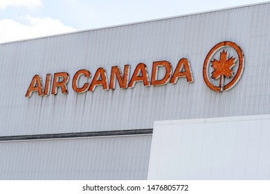 Mississauga, Ontario, Canada - August 11, 2019: Sign and log of Air Canada on the building at its headquarters in Mississauga, Ontario. Air Canada is the largest airline of Canada.