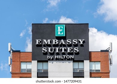 Mississauga, Ontario, Canada - August 11, 2019: Sign of  Embassy Suites by Hilton on the building near Pearson Airport in Mississauga, Ontario, Canada,  a chain of upscale all-suite hotels by Hilton.