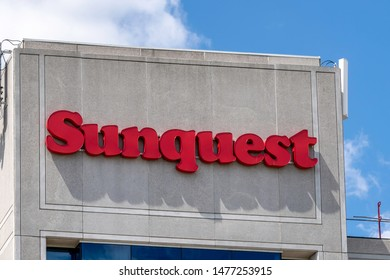 Mississauga, Ontario, Canada - August 11, 2019: Sign of Sunquest on the building in Mississauga, Ontario, Canada, a travel agency in Mississauga, Ontario.