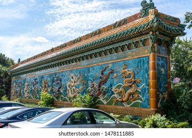 Mississauga, Ontario, Canada - August 11, 2019: Nine-Dragon Wall in Mississauga Chinatown, Ontario, Canada. Mississauga Chinatowns is an ethnic neighborhood .