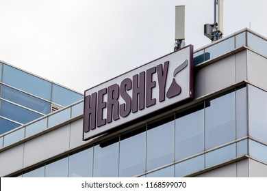 Mississauga, Ontario, Canada- August 25, 2018: Sign of Hershey on the building of Hershey Canada in Mississauga, an American company and one of the largest chocolate manufacturers in the world.