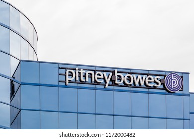 Mississauga, Ontario, Canada- August 25, 2018: Sign of  Pitney Bowes on the building of Canada Head Office in Mississauga, a technology company for postage meters and mailing equipment and services.