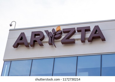 Mississauga, Ontario, Canada - August 25, 2018: Sign of ARYZTA on the building of ARYZTA Canada head office in Mississauga, ARYZTA is a food business based in Zurich.
