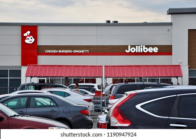 Mississauga, Ontario, Canada - July 31, 2018: Cars in front of Jollibee restaurant in Mississauga.