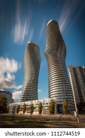 Mississauga, Ontario / Canada - June 12, 2016: Absolute Towers in Mississauga, Ontario during golden hour with streaking clouds.