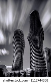 Mississauga, Ontario / Canada - June 12, 2016: The Absolute Towers located in Mississauga, Ontario in black and white against a cloud streaked sky.