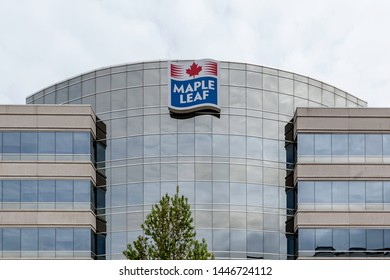 Mississauga, Ontario, Canada- May 12, 2018: Sign of Maple Leaf on the building in Mississauga. Maple Leaf Foods Inc. is a major Canadian consumer packaged meats company.