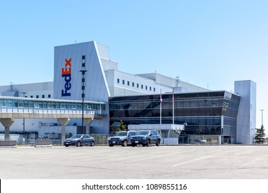 Mississauga, Ontario, Canada - May 13, 2018: FedEx sign on the building in FedEx Ship Centre in Mississauga. FedEx Corporation is an American multinational courier delivery services company.
