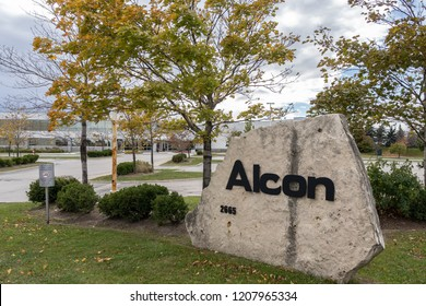 Mississauga, Ontario, Canada- October 20, 2018: Sign of Alcon on the Canadian head office building in Mississauga. Alcon is a global medical company specializing in eye care products.