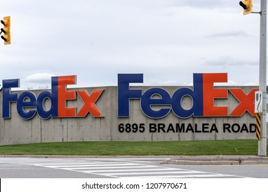 Mississauga, Ontario, Canada -October 20, 2018: FedEx sign at FedEx Ship Centre in Mississauga. FedEx Corporation is an American multinational courier delivery services company