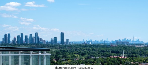 Mississauga and Toronto Skylines Seen from a High Rise on a Bright Sunny Day