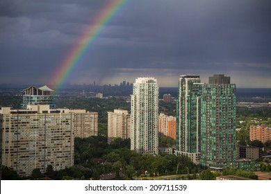 Mississauga West of Toronto Rainbow. A rainbow over Mississauga, Canada with Toronto in the background, during a summer storm passing through.