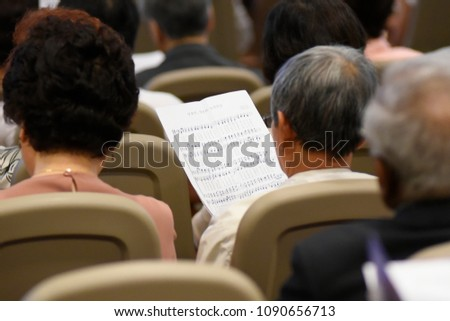 MISSISSAUGA-AUGUST 13:People reading the song notations which Pastor Hyeon Soo wrote while he was in North Korean prison during the celebration of his release on August 13 2017 in Mississauga,Canada.