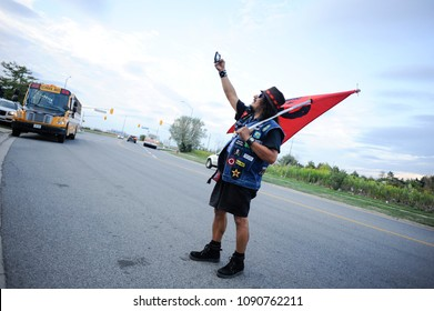 MISSISSAUGA-AUGUST 25: An activist taking selfie during a rally to protest the death of Abdirahman Abdi-a Somali-Canadian killed by Ottawa Police  on August 25 2016 in Mississauga,Canada.