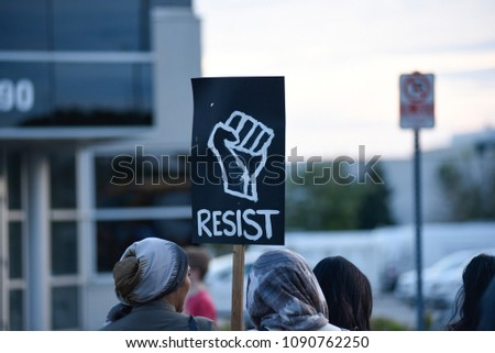 MISSISSAUGA-AUGUST 25:People with signs asking to resist police brutality while protesting the death of Abdirahman Abdi-a Somali-Canadian killed by Police on August 25 2016 in Mississauga,Canada