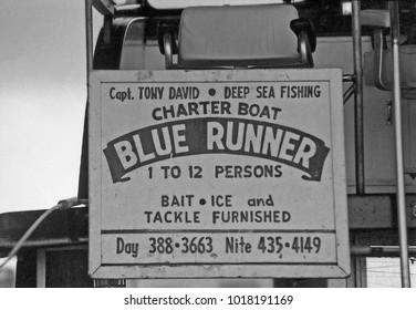 MISSISSIPPI, BILOXI – SEPTEMBER 16, 1979: sign of Blue Runner deep sea fishing charter boat. Vintage picture taken in 1979.