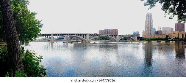 Mississippi River Banks in Minneapolis, Minnesota - Summer Day with Calm Water