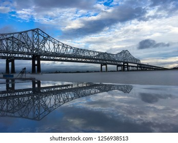 Mississippi River Bridge and reflection over Mighty Mississippi with light fog