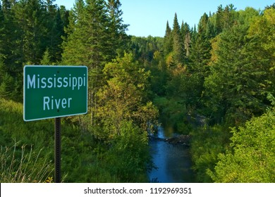 Mississippi River flowing north near its source at Itasca State Park in Minnesota. This sign is at one of the first bridges over the Mississippi River.