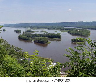Mississippi river Lansing Iowa from cliffs high above. Bushes and islands in the river.