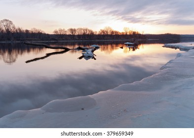 mississippi river in south saint paul minnesota at daybreak in winter along icy banks