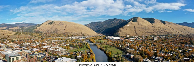 "MISSOULA, MONTANA - October 18th, 2018: Concerned citizens redecorated the University of Montana ""M"" to spell ""iMPEACH"", and the Mt. Jumbo ""L"" to say ""LIAR"", just before a rally for Donald Trump."