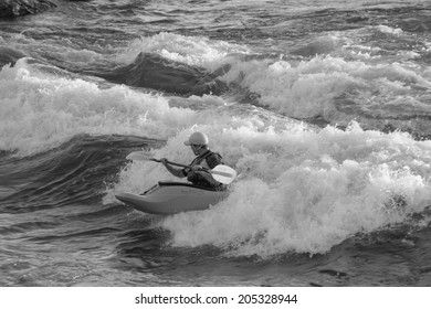MISSOULA, MONTANA/U.S. - JULY 1:  Man kayaking Brennan's wave on July 1, 2014, in Missoula, Montana.  Brennan's wave is an engineered whitewater wave on the Clark Fork River, downtown Missoula.