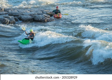 MISSOULA, MONTANA/U.S. - JULY 1:  Two men kayaking Brennan's wave on July 1, 2014, in Missoula, Montana.  Brennan's wave is an engineered whitewater wave on the Clark Fork River, downtown Missoula.