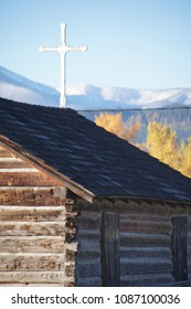 Missoula, Montana/USA- October 21, 2014: A vertical image of one the outbuildings, and white roof cross, at the Fort Missoula historic site.