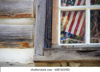 Missoula, Montana/USA- October 21, 2014: A horizontal image of the United States flag seen through the exterior window of one of the buildings at the Fort Missoula historic site.