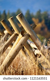 Missoula, Montana/USA- October 21, 2014: A vertical image of fence posts set on a diagonal at the Fort Missoula historic site.