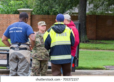 Missouri City, Texas -August 29, 2017: Texas National Guard and first responders working together to assist with emergency operations. Heavy rains from hurricane Harvey caused many floods near Houston