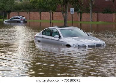 Missouri City, Texas - August 30, 2017: Cars submerged from hurricane Harvey in Sienna Plantation. Heavy rains from hurricane Harvey caused many flooded areas in Houston suburbs