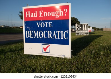 Missouri City, Texas - October 13, 2018: Vote Democratic and Beto O'Rourke election signs are seen in many residential areas in Texas.