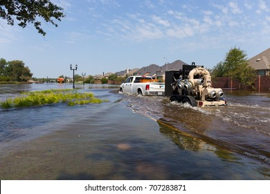 Missouri City, Texas - September 1, 2017: Mobile flood pumps are brought to the Riverstone neighborhood for disaster relief after hurricane Harvey
