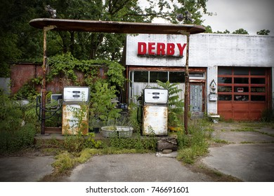 Missouri, United States - circa June 2016 Old, abandoned Derby gasoline station with Gas Pumps and Weeds Growing on route 66 in a small town in Missouri. Overgrown with weeds.