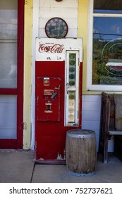 Missouri, United States - circa June 2016 - old vintage antique glass bottle Coke machine on porch of antique store route 66
