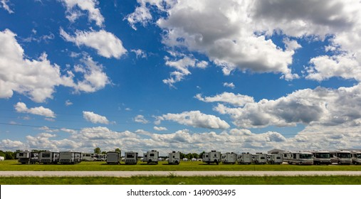 Missouri USA, countryside. May 12, 2019. RV parking. Motorhomes parked on green grass, blue cloudy sky, sunny spring day, family vacations concept