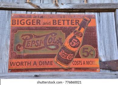 Missouri, Usa - July 19, 2017: Old rusty vintage sign with Pepsi logo in Missouri, Usa.