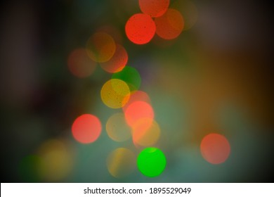 Mist bokeh defocused christmaslights. Many celebration garlan lights defocused on colorful background