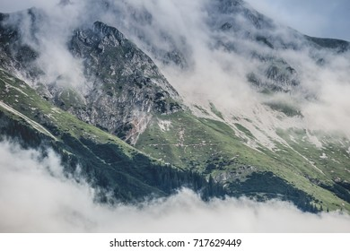 Mist covering mountain side near Innsbruck, Austria.