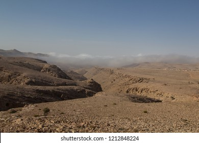 Mist crawling up a canyon in the Salma plateau in the Sultanate of Oman
