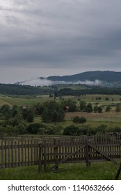mist in distance over the fence of farm
