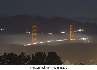 Mist in Golden Gate Bridge at night, San Francisco, California.