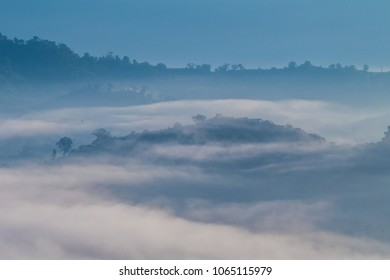 The mist moves over the mountains in the morning.