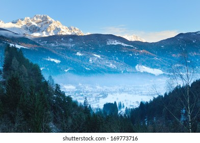 mist over Pinzolo (TN) Italy ski area at sunset