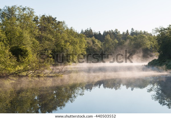 Mist over the river at sunrise.