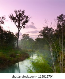 Mist rising from the San Marcos River in Texas at dawn.
