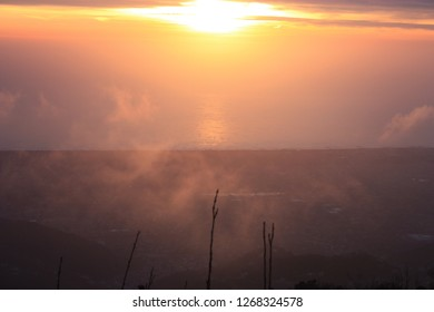 mist and sunlight. high up by the Apuan mountains of Tuscany. the sea of versilia is painted in the warm colors of the sunset. red, yellow and orange
