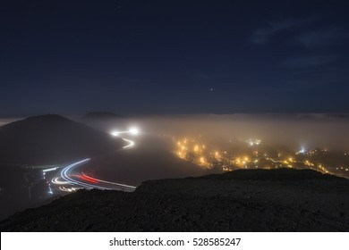Mist in twin peaks at night, San Francisco, California.